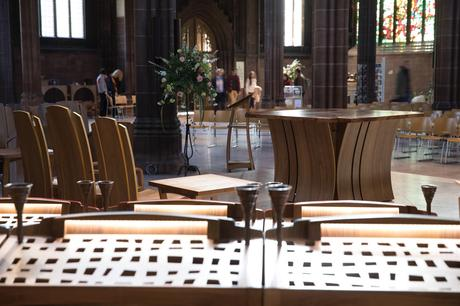 Altar, lectern and celebrants chairs with choir reader in foreground, Manchester Cathedral