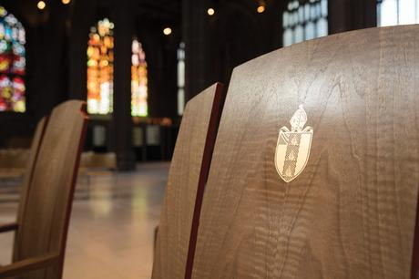 Clergy chairs at Manchester Cathedral with bishop's crest