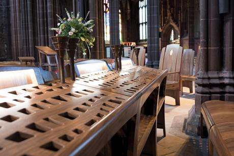 Choir readers with fishing net lattice design and candle holders, Manchester Cathedral
