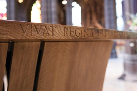 Altar dedication carved into the burr elm top edge, Manchester Cathedral