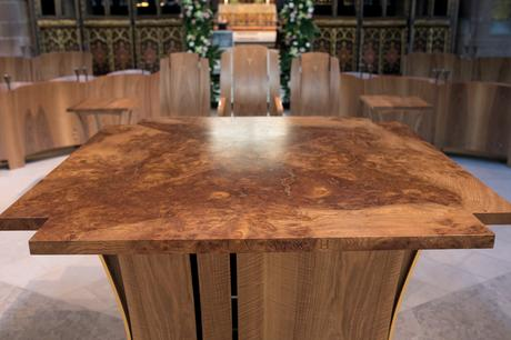 The matched quarters of the solid burr elm altar top showing bronze resin fill, Manchester Cathedral