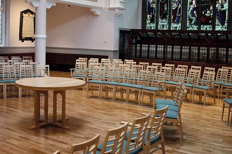 Wesley Methodist Church communion table and upholstered stacking chairs