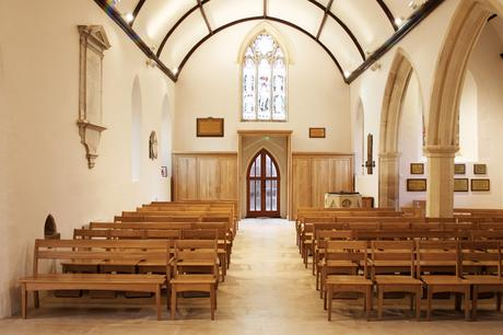 A view of the nave of St John the Evangelist with new seating and storage either side of the entrance