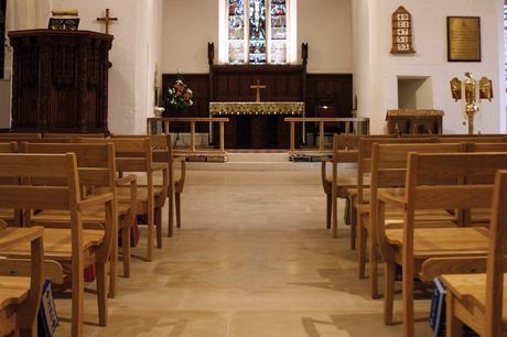 Looking to the chancel in St John the Evangelist with new oak chairs and benches in the foreground