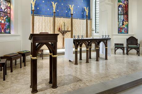 Stained oak ambo, altar and sanctuary furniture with gold painted details, St Joseph's Stokesley