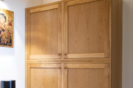 Entrance area storage cupboard with carved lettering, St Joseph's Stokesley