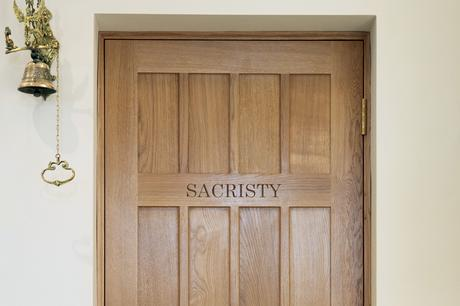 Sacristy door with carved lettering, St Joseph's Stokesley